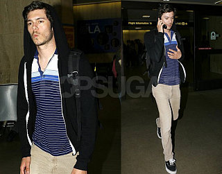 Adam Goes to LAX, Prob Not Whistling OC Theme Song