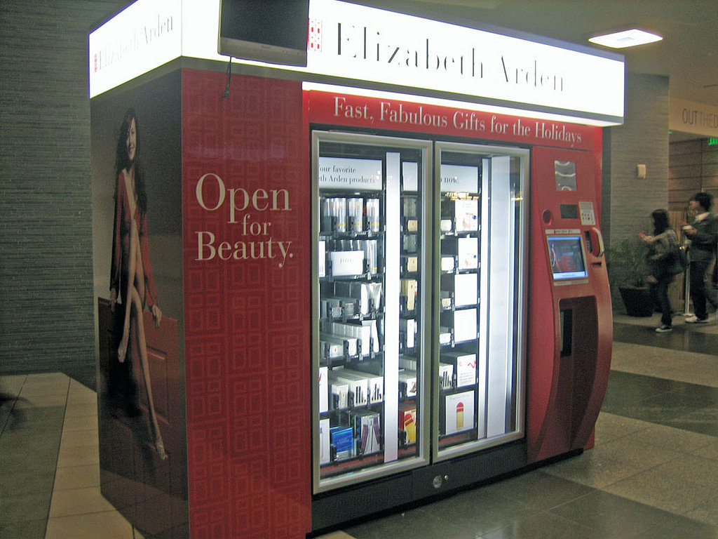Check Out the Elizabeth Arden Vending Machine 1/04/08POPSUGARBeautyElizabeth ArdenCheck Out the Elizabeth Arden Vending Machine December 18, 2007 by Beauty7 Shares View on One Page Photo 1 of 3 ← Use Arrows Keys!!! → 1 Check Out the Elizabeth Arden Vending Machine This weekend, I was dodging the crazy crowds at a shopping center in San Francisco. As I was on my way out, I ran across this large Elizabeth Arden vending machine. Selling items through vending machines is nothing new in the tech world, and for that matter, it's pretty common in Japan. But this is the first time I've seen beauty products being sold in this manner.The vending machine was stocked with Intervene Eye, Prevage night cream, fragrances, and gift sets. (No sign of color cosmetics, though.) You could shop through a touch-screen, bypassing the beauty counter completely. Although a few dudes were curious about the giant beauty machine, most women looked at it and walked right by. I think this is probably more of a marketing tactic tha - 웹