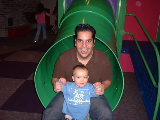 Daddy and Keanu at the bottom of a slide
