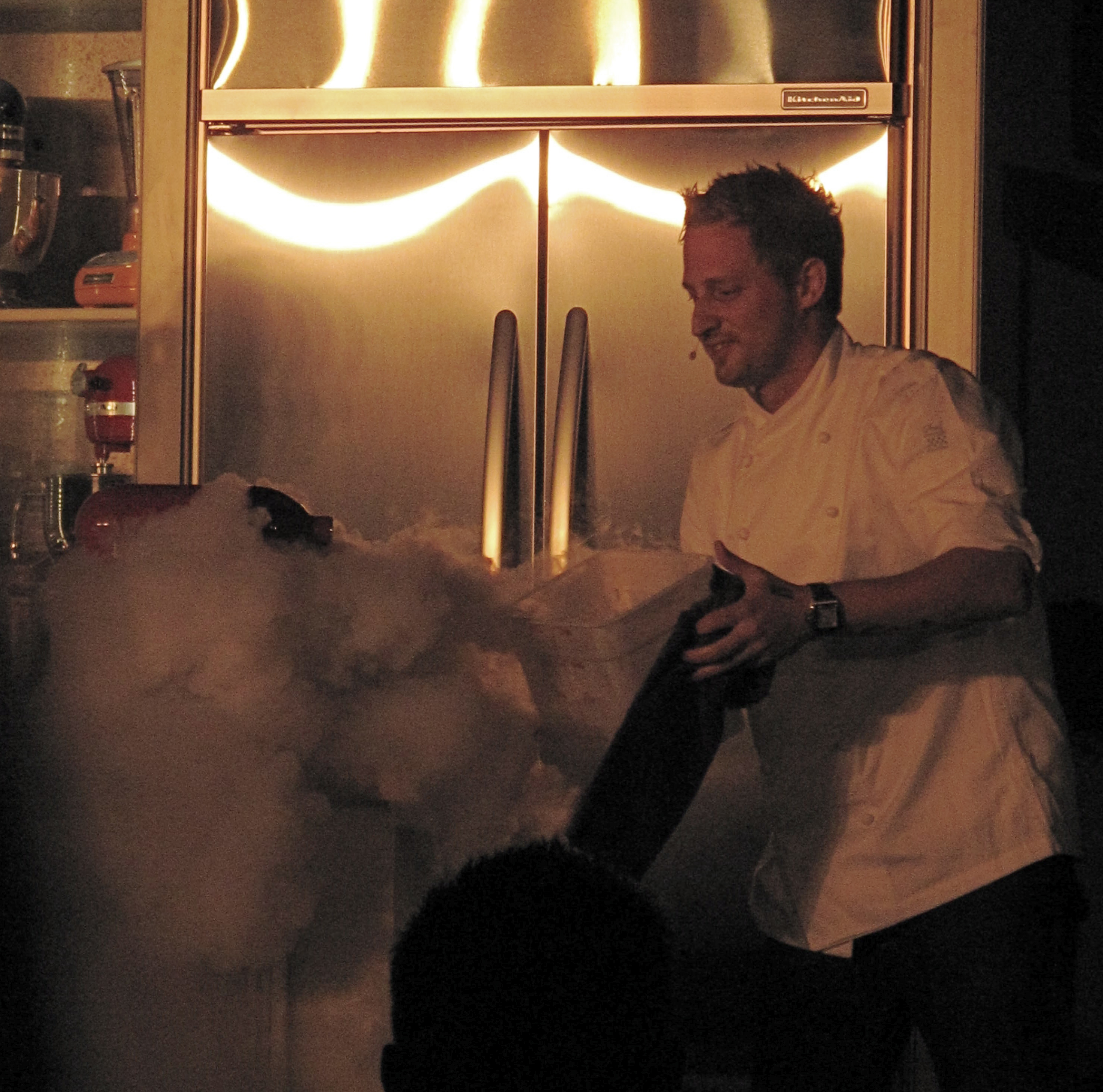 Michael buried in some serious liquid nitro clouds. He used the high-tech ingredient to create a frozen sangria as his first dish.