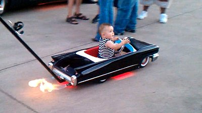 "Incredible ""Cadillac"" Baby Stroller Shoots Flames (VIDEO)"