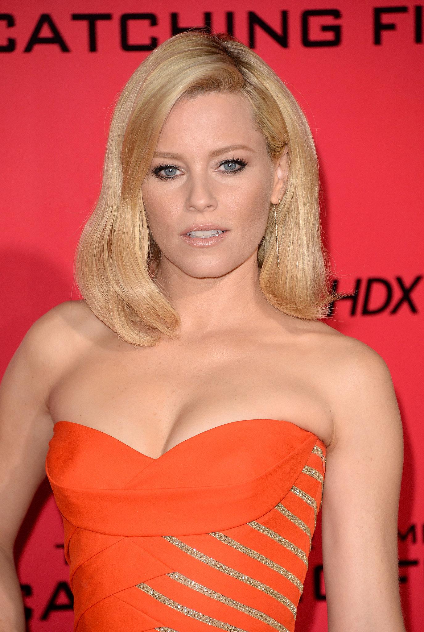 http://media1.popsugar-assets.com/files/2013/11/18/213/n/1922398/b4f6bd318a630664_450456007_10.xxxlarge_2x/i/Elizabeth-Banks-wore-flattering-orange-dress.jpg