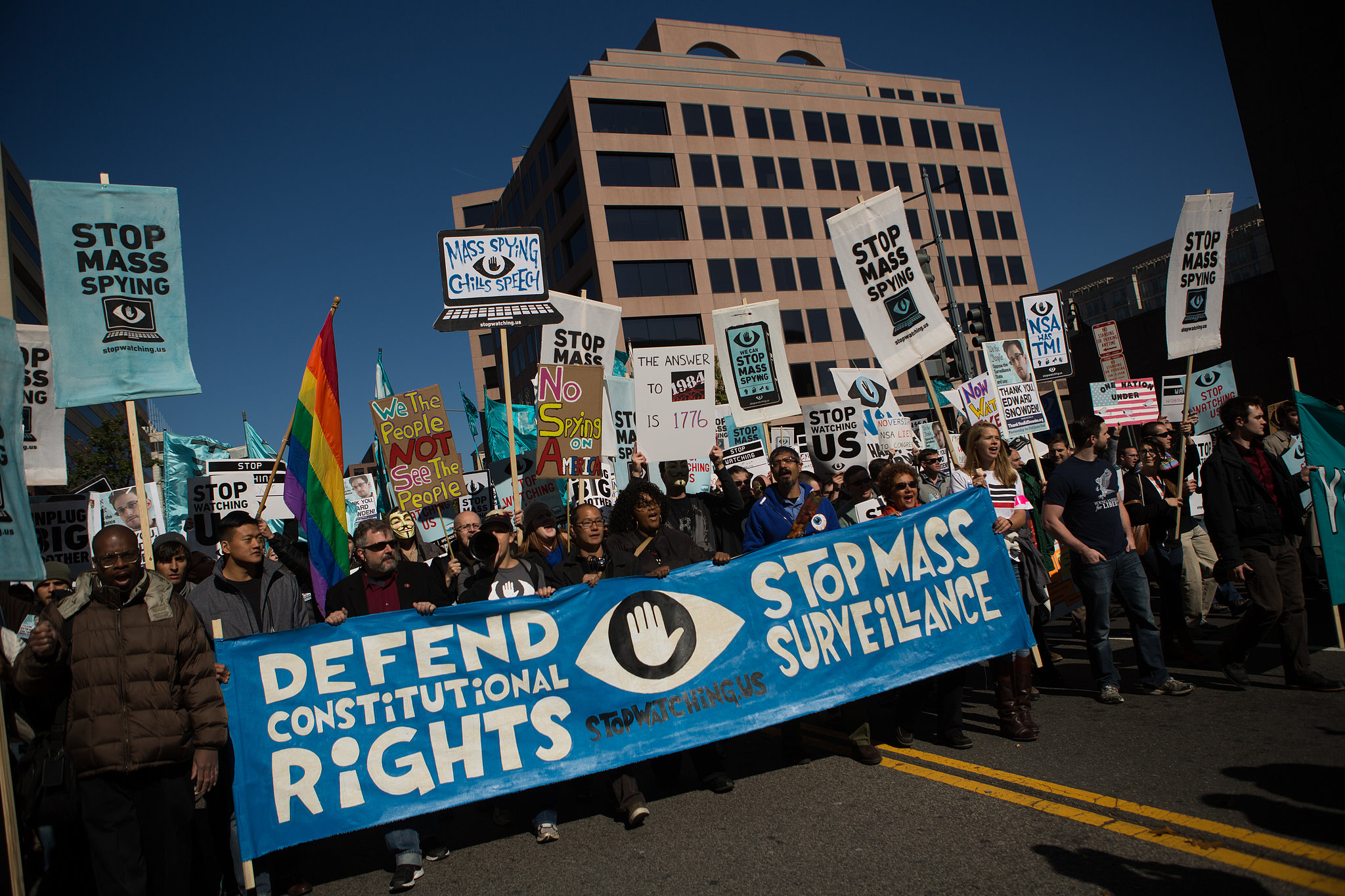 Pro-privacy demonstrators march in front of the US Capitol building on Oct. 26, 2013.