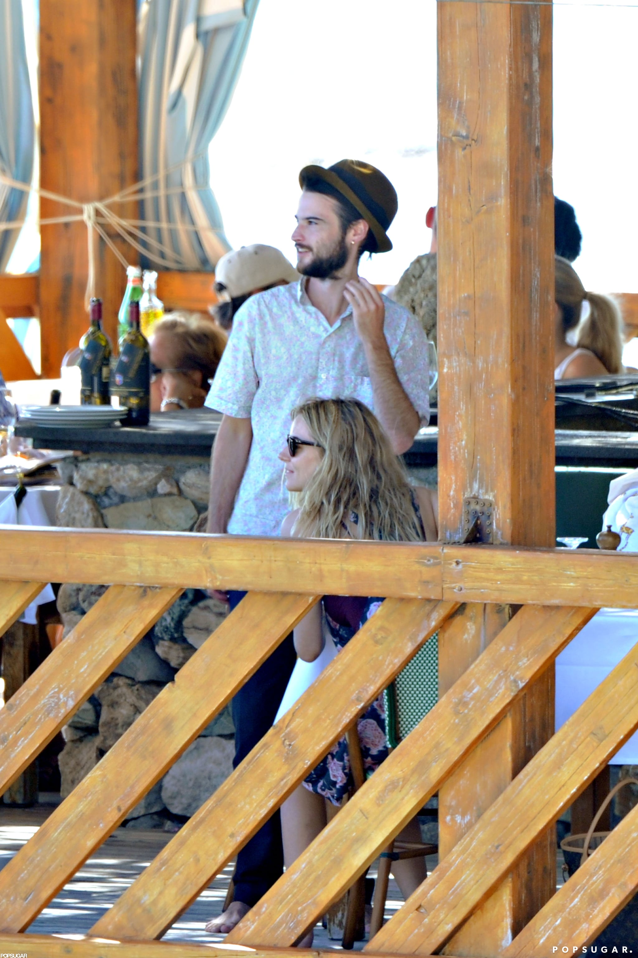 Tom Sturridge and Sienna Miller boarded a boat in Positano.