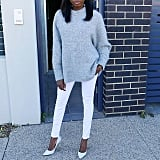 With a Gray Sweater and White Heels