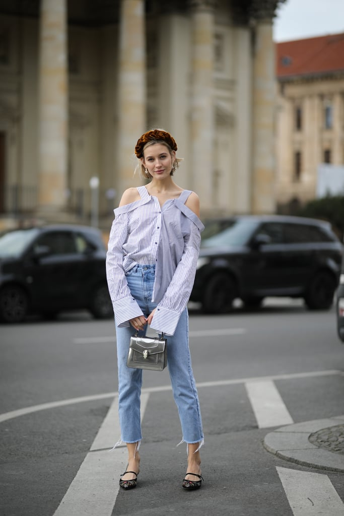 A flirty open-shouldered blouse is fresh counter to mom jeans