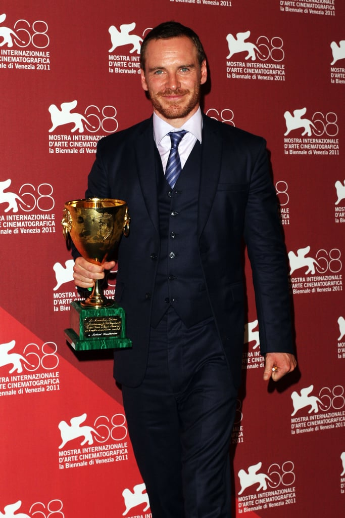 Michael Fassbender with his best actor prize in Venice.