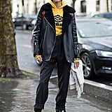 Toughen Up Your Look With a Leather Jacket and a Yellow Hoodie