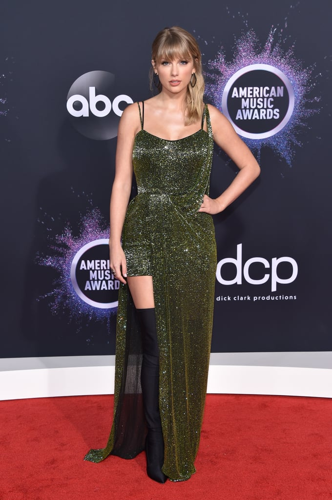 "Taylor Swift was the guest of honour at the American Music Awards on Sunday night. The ""Lover"" singer, who is receiving the artist of the decade award during the show, looked absolutely stunning as she hit the red carpet in sparkly green dress and thigh-high boots. Perhaps she and BFF Selena Gomez planned their outfits together? In addition to her big award, Taylor is also set to perform during the show. Although, it's unclear if she will sing any of her past hits following the drama between her and her previous record label, Big Machine Records. Earlier this month, Taylor gave fans an update on her ongoing feud with Scott Borchetta and Scooter Braun, claiming that that they wouldn't give her permission to perform her older hits due to legal issues. Something tells us Taylor will use the AMAs as an opportunity to make another statement about the controversy.       Related:                                                                                                           Taylor Swift Always Has the Most Fun at the American Music Awards, and We Have Receipts"