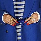 Gold rings and red nails added a cool-girl touch to her outfit.