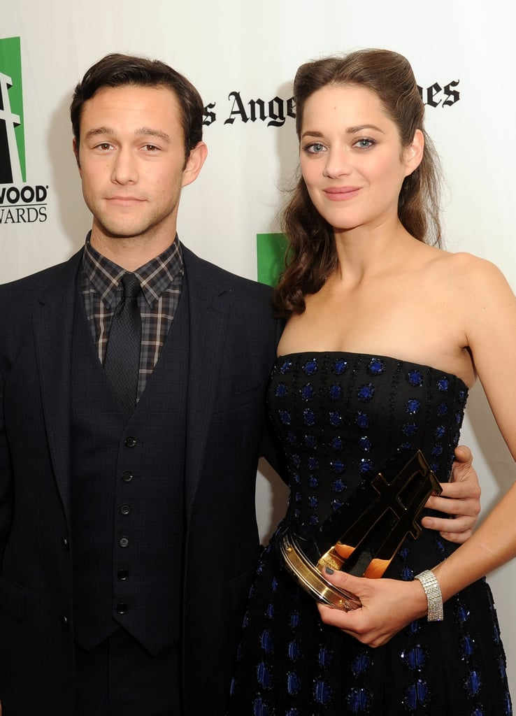 Marion Cotillard posed on the red carpet with her award and Joseph Gordon-Levitt.