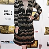 Ginnifer Goodwin selected a unique metallic black and gold Viktor & Rolf sheath with a sheer inset at the neckline.