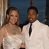Nick Cannon and Mariah Carey snapped photos with the Eiffel Tower directly behind them.