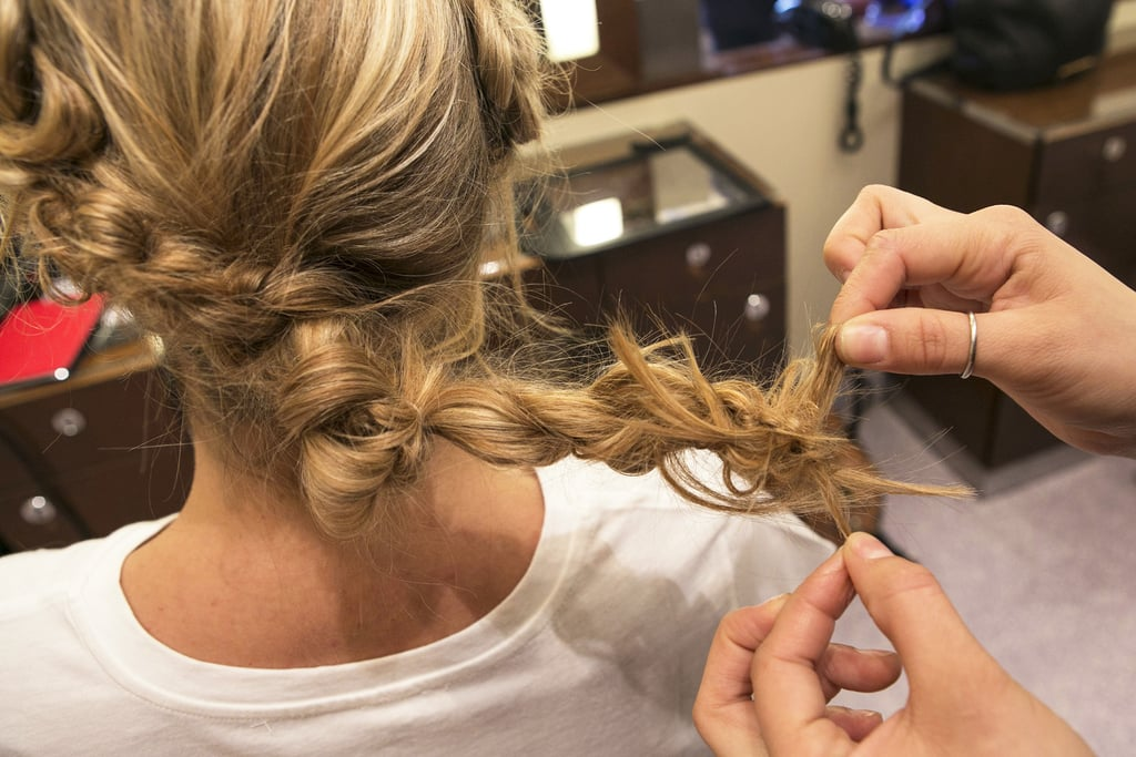 Next, knot the ponytail and secure with an elastic.