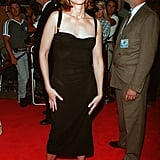 Julia worked a bustier style midi dress with peep-toe sandals at the Conspiracy Theory premiere in 1997.