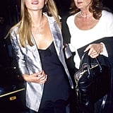 With mom Linda in 1995, wearing a silver blaxer over a slip dress.