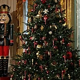 A larger-than-life nutcracker stands guard over the Christmas tree in the East Room.