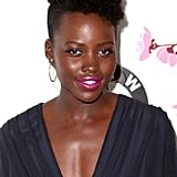 "First Lancome memory:  ""Using one of its blushes for my first big red carpet at the Toronto Film Festival. I just remember thinking, 'Wow.' Blush can often be a rather foreign idea for dark skin. It can also look kind of contrived or forced, because we don't blush naturally. It gave a rosiness, a warmth, to my face without being too obvious or too conspicuous, and I liked that."" Specific color recommendations for wearing blush if you have a deeper skin tone? ""I would say that you want to go with the plumier colors more so than the peachier colors. It just needs to be a little deeper."" What inspires her bold-colored makeup choices on the red carpet? ""I want to have fun, and I am lucky enough to get to play dress-up very often. It's a moment of experimentation and of whimsy and fantasy, really. And I just like to embrace that."""