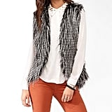 Give any of your party looks a little more luxe (and warmth!) with a faux-fur vest like this Forever 21 Striped Faux-Fur Vest ($25).