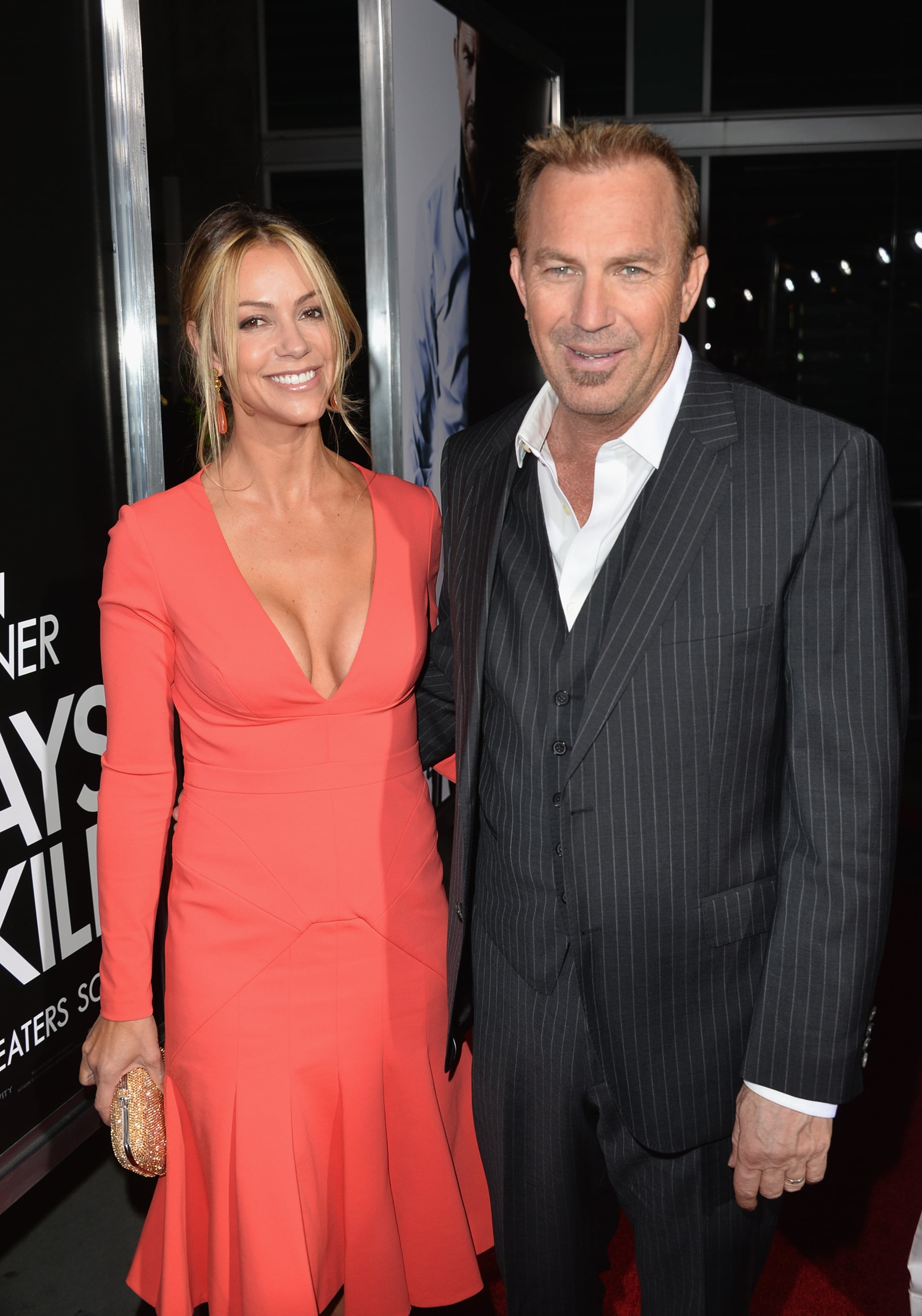 Kevin Costner and his wife, Christine Baumgartner, also turned the | Premiere PDA! Johnny and Amber Heat Up the Red Carpet | POPSUGAR Celebrity Photo 4