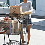 Halle Berry brings groceries to her car.