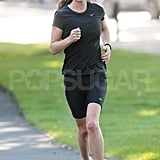 Pippa Middleton runs through a park.