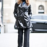 A shiny peacoat added a cool dimnesion to all-black basics.