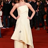 When The Hunger Games: Catching Fire premiered in Rome, Jennifer Lawrence went with a sculptural vanilla silk Dior Haute Couture gown and gold sandals.