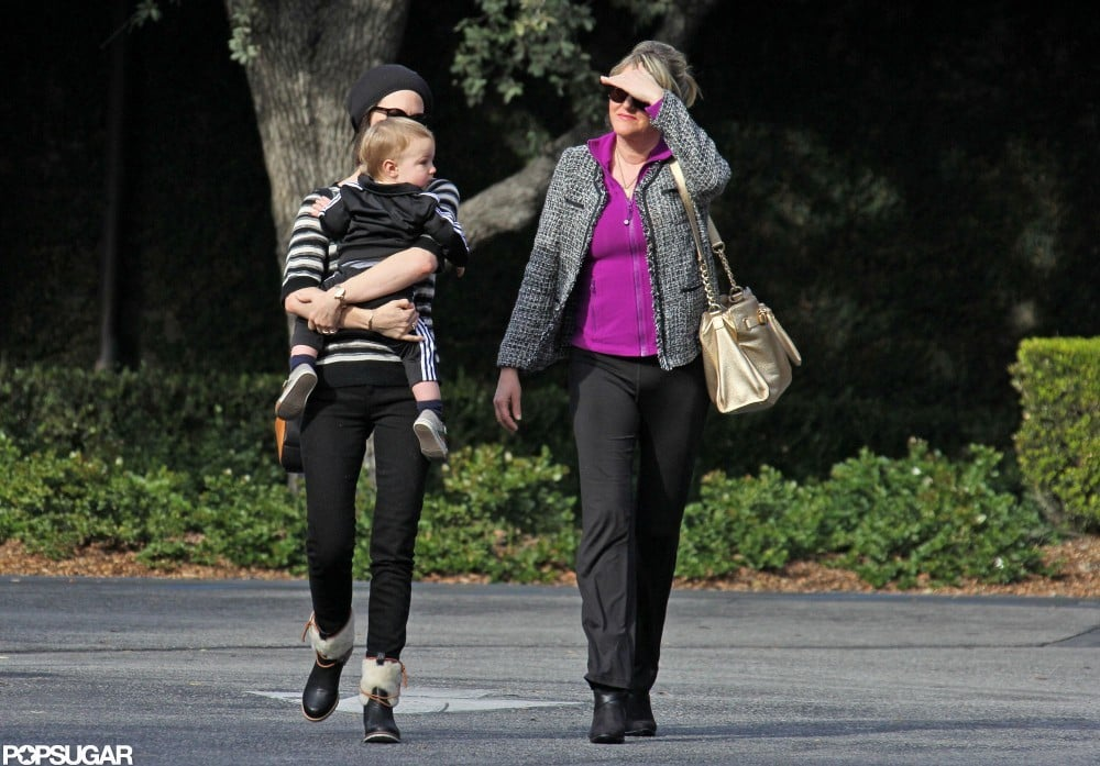 January Jones held Xander as she stepped out with her mom, Karen, in LA.