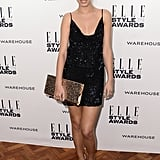 Like we said, if you're not sure what to wear, look to your trusty LBD. Amber Le Bon sparkled in a slinky black mini, accessorising with a copper envelope clutch and equally eye-catching, metallic strappy sandals.