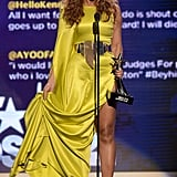 Beyonce gathered her train on stage and showcased the sultry side slit on her gown. We love that she accessorized with the same bold metallic belt that Stéphane Rolland showcased on the runway.