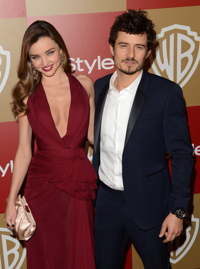 Orlando Bloom and Miranda Kerr put their arms around each other.
