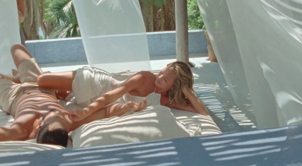 "Chrissy Teigen Reveals Pregnancy in a White Dress in ""Wild"""