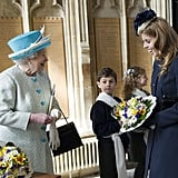 Princess Beatrice once again helped the queen hold her flowers.