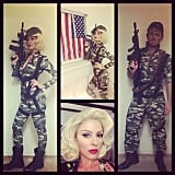 Maria Menounos's Marilyn Monroe-inspired wig and hot lipstick made her look like a glamorous paratrooper. She coordinated with hair and makeup artist Dimitris Giannetos.