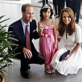 Prince William and Kate Middleton posed with 4-year-old Maeve Low (note her adorable dress and tiara) during a stop in Singapore during their Diamond Jubilee tour in September 2012.