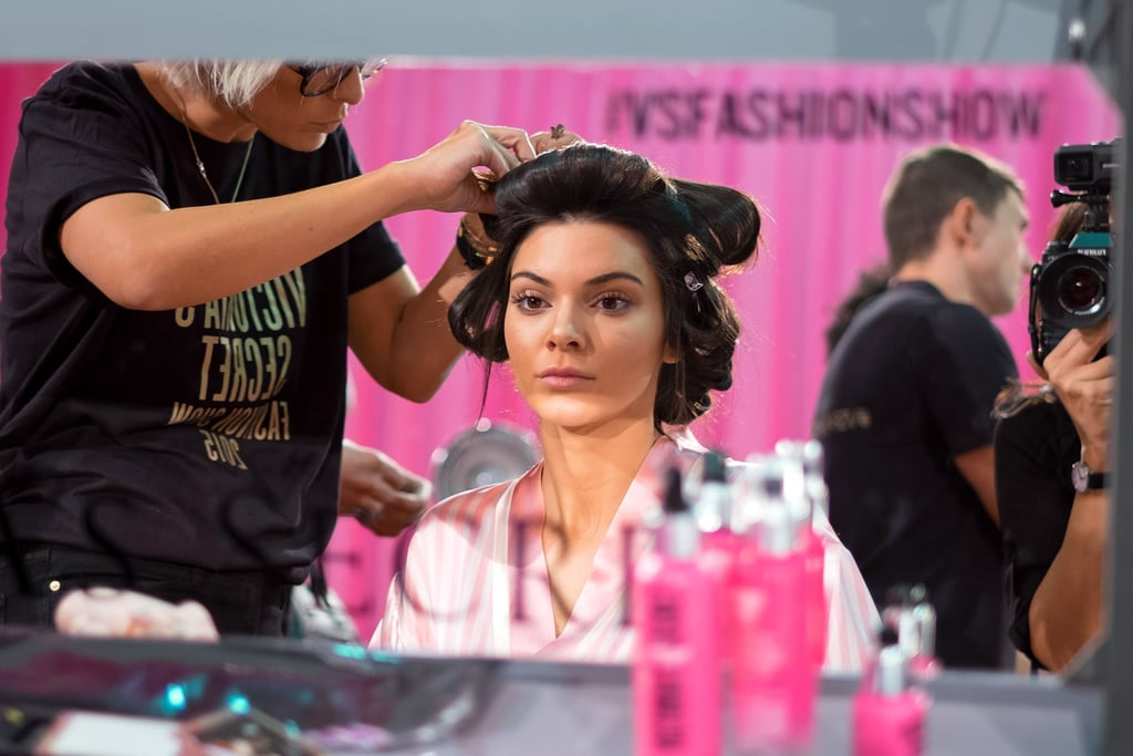 27e1ac0659 Kendall Jenner looks at her flawless skin as she gets her hair ...