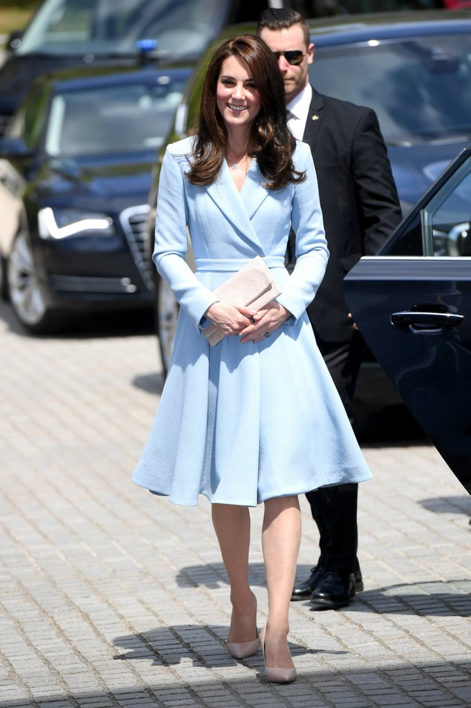 If there's one color Kate Middleton doesn't lack in her wardrobe, it's blue. The Duchess of Cambridge wears shades from navy to cobalt so often that we've labeled it her power color. Kate gravitated towards this calming hue once again for a visit to Luxembourg, where she wore a pastel Emilia Wickstead coatdress. It was elegant and simple, a classic Kate look we've all come to appreciate.  Though coatdresses are part of Kate's everyday wardrobe, there's likely a special reason the royal wore a blue one. The outerwear coincidentally matched the colors of the Luxembourg flag (FYI it's red, white, and blue). This small nod to the country and its people did not go unnoticed and most importantly, Kate glowed in the outfit. Read on to see the coatdress from all angles, then shop similar outerwear options below.