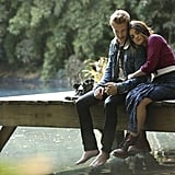Aria (Lucy Hale) cuddles up to the mysterious new character. Source: ABC Family