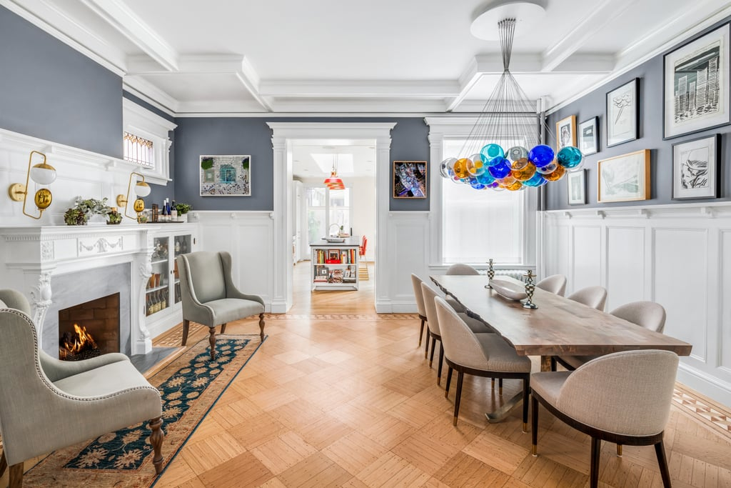 "Emily Blunt and John Krasinski have proven themselves savvy real estate flippers time and time again, but their latest project takes them away from the sleek California properties they're used to — who could forget the sexy modern home they remodeled and sold to Kendall Jenner? — and into historic NYC territory. Last Fall, the duo purchased a spacious four-story 1909 townhouse in the hip Brooklyn neighborhood of Park Slope for $6 million. And just a year later, they've completed renovations and relisted the French Renaissance Revival-style property for a whopping $8 million.  So what did they do to justify the crazy price increase? For starters, it seems they've expanded the living space nearly 1,000 square feet to a palatial 5,200 square feet and added a couple of bedrooms. Beyond additions, they've modernized the home in the most luxurious way, updating primary living spaces like the kitchen, dining room, and family room with top-of-the-line appliances and bright and airy design touches. During the reno, they've clearly taken care to maintain the home's period charm, leaving original details such as stained glass windows, built-in leaded glass cabinets, artisan crown moldings, and more intact. ""No expense was spared in this historical and pedigreed renovation,"" says the real estate listing, held by Corcoran agents Karen Talbott and Kyle Talbott. Take a look at all the stunning design details in the photos ahead."