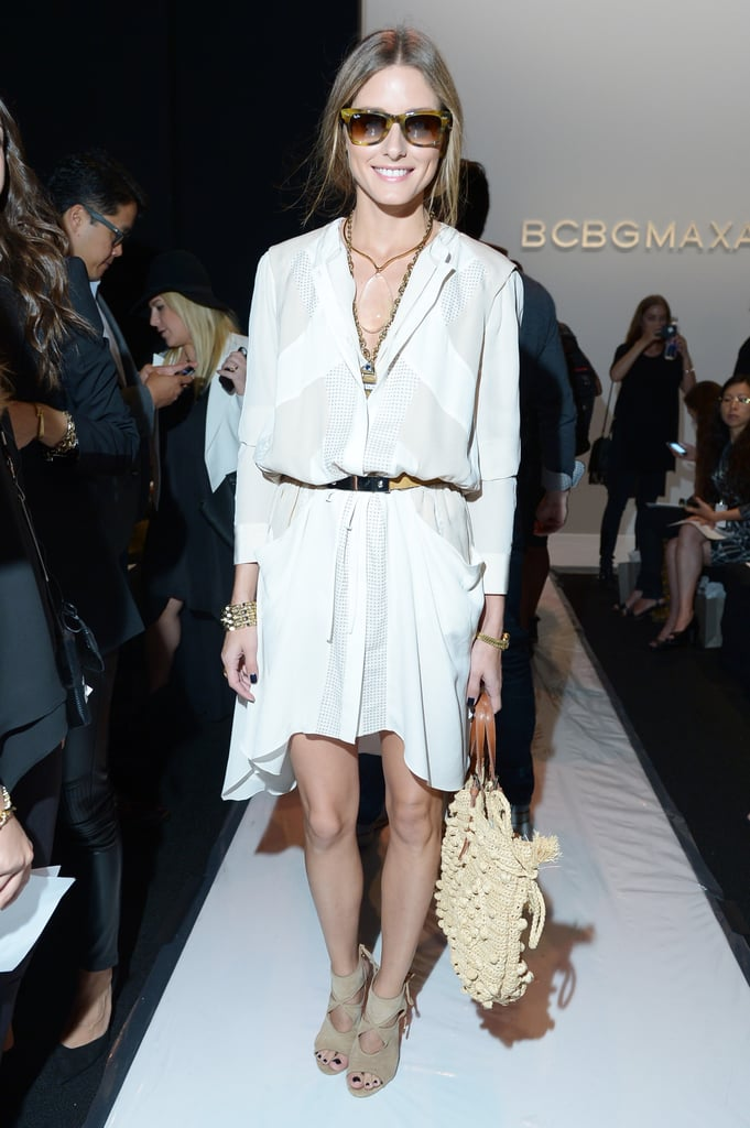 Olivia Palermo hit BCBG Max Azria looking fresh in a white BCBG Max Azria dress, accentuated with neutral accessories and gold jewels.