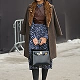 Miroslava Duma looks like she just stepped off of a train in 1940s Russia.
