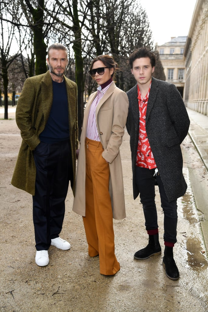 "When it comes to celebrity families, few compare to the Beckham brood. On Thursday, Victoria, David, and Brooklyn stepped out in style for the Louis Vuitton men's show in Paris. The trio donned similar coats and trousers for the fashion-forward event, but it was ultimately Brooklyn's Hawaiian shirt that we couldn't take our eyes off. Once inside, the family made their way to the front row, where they attentively took in the show.  Victoria also shared a backstage photo with Louis Vuitton's artistic director Kim Jones on Instagram, writing, ""Emotional day for @mrkimjones X so pleased to be here for you x kisses from Paris x @davidbeckham @brooklynbeckham @louisvuitton 🇫🇷."" Sadly, the rest of the clan — Romeo, Cruz, and Harper — didn't make an appearance, but hopefully Victoria will share more sweet family moments on social media soon!      Related:                                                                                                           27 Times Victoria Beckham Was Hands Down the Best Person on Instagram"