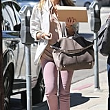 Jessica Alba carried her purse and a box in Beverly Hills.