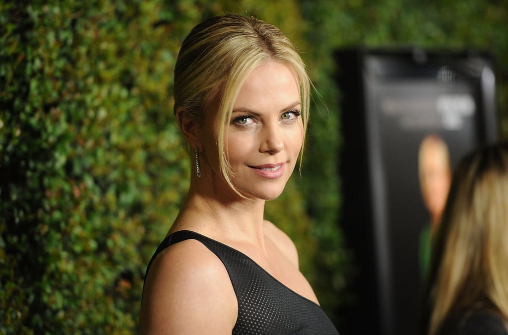 Charlize Theron smiled at photographers.