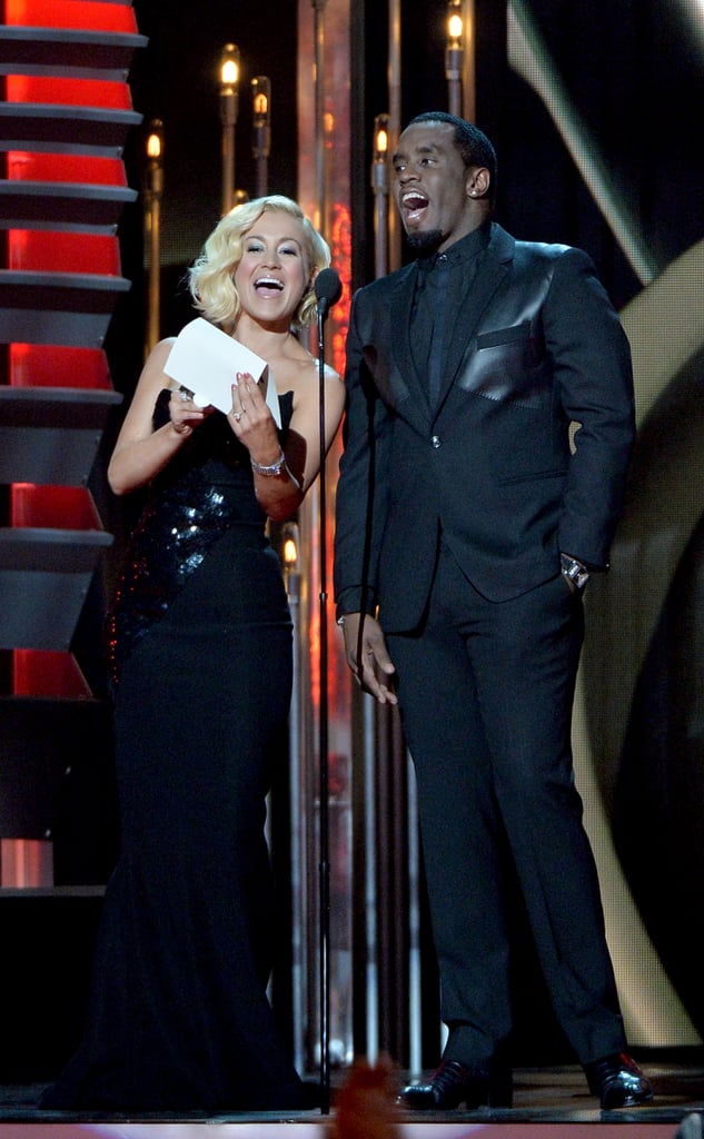 Kellie Pickler and Diddy presented an award on stage.