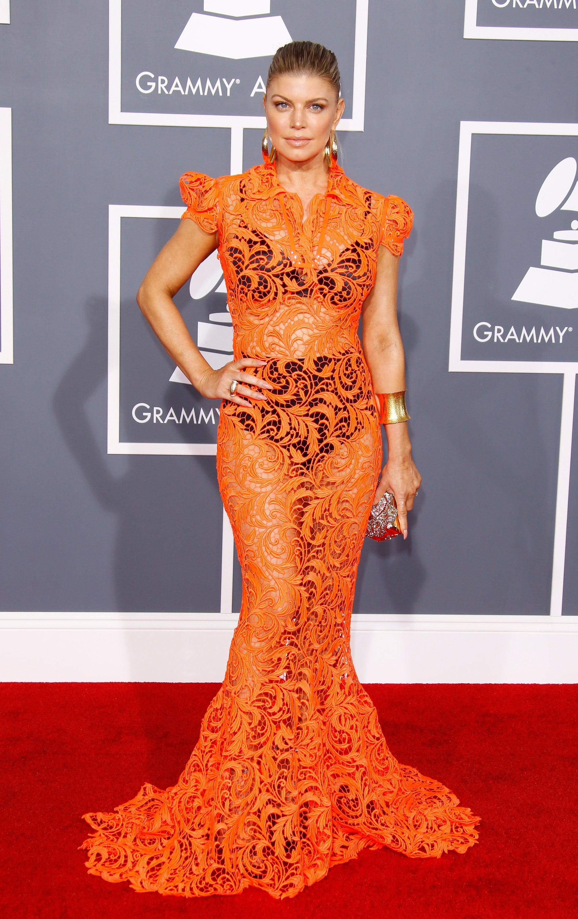 Fergie donned an orange lace Roberto Cavalli gown on the red carpet in 2012.