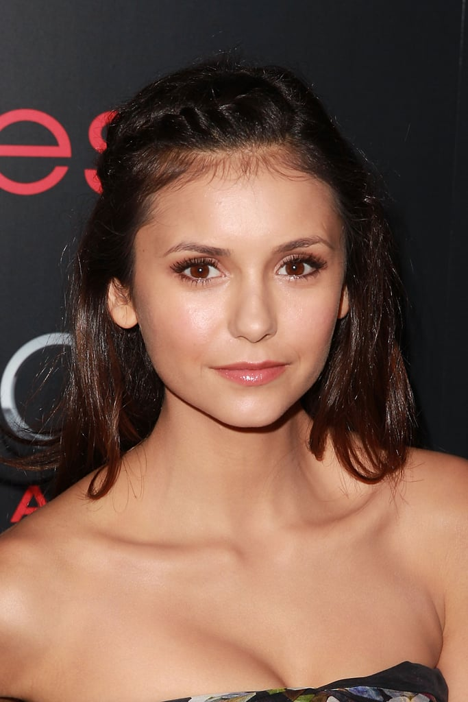 A braid doesn't always have to be the main event; Nina Dobrev added a tiny braid along her hairline to add some character to her style.