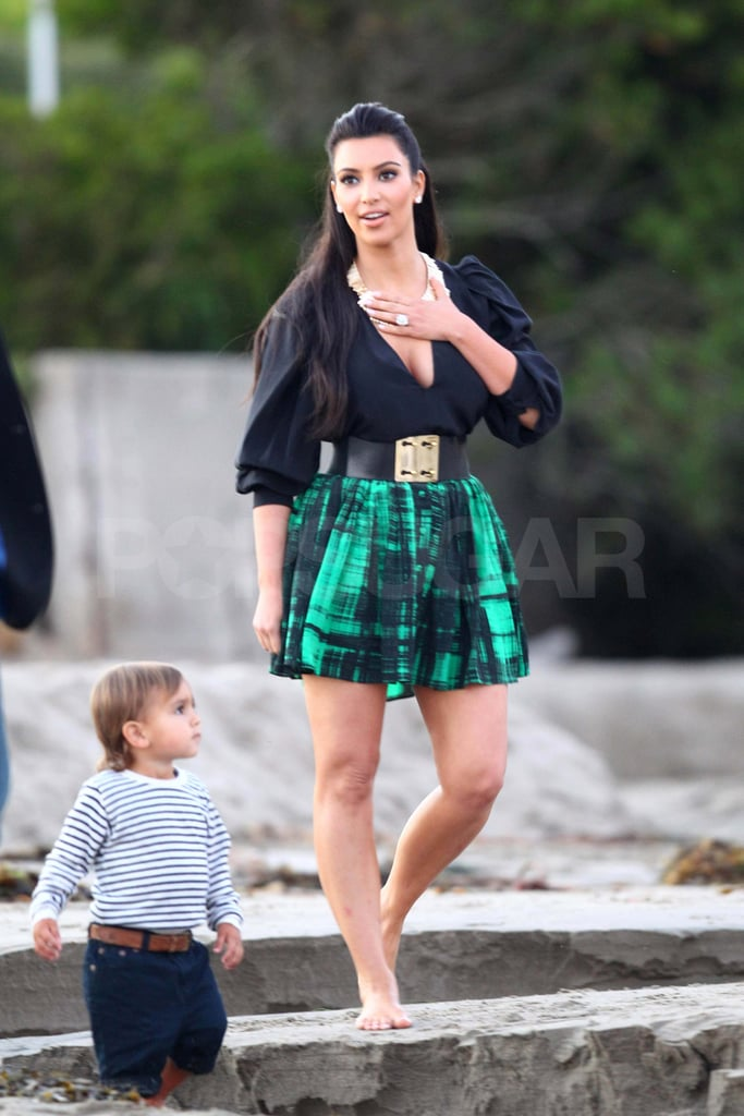 "Kim Kardashian kicked off her shoes to take pictures at a beach in LA yesterday. She and her nephew Mason, along with photographers and a camera crew, captured a few sweet moments in the sand just hours before Kim's big day. The quick photo session was part of an evening that also included another prewedding gathering in Montecito, where Kim and Kris Humphries will tie the knot today. The duo already hosted a rehearsal dinner in Beverly Hills on Thursday, and it looks like the latest event was also full of friends and family. Kim finished her fun night off with a brow treatment by Anastasia and she was up early this morning to share her excitement about her nuptials. Kim exclaimed, ""Today is the day!"" on her website and urged fans to sign her virtual guest book."