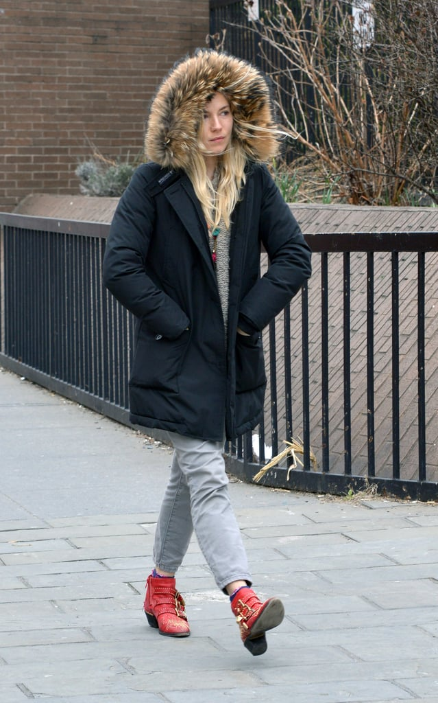 Sienna Miller tucked her hands in her pockets.
